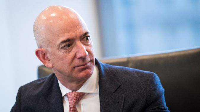 NEW YORK, NY - DECEMBER 14: Jeff Bezos, chief executive officer of Amazon, listens during a meeting of technology executives and President-elect Donald Trump at Trump Tower, December 14, 2016 in New York City.