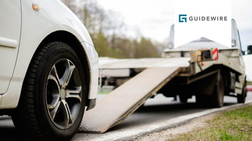 loading-broken-car-on-tow-truck