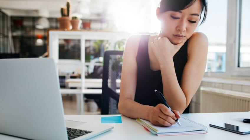 asian-businesswoman-writing-notes