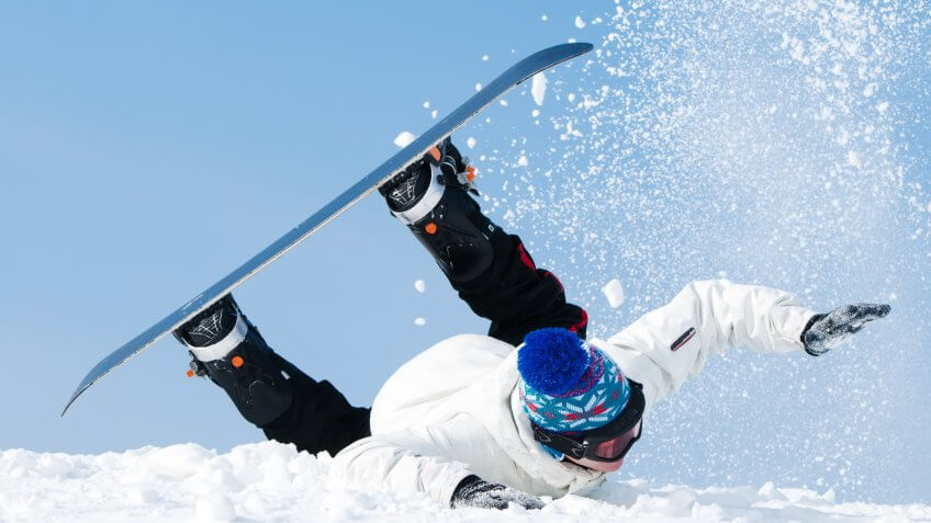 falling-young-man-on-snowboard-snowy