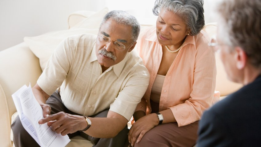 African American,  Caucasian,  Color Image,  Friend,  Indoors,  People,  Three People,  Woman,  african ethnicity,  asking,  checking,  contract,  couple,  document,  girlfriend,  heterosexual couple,  high angle view,  horizontal,  husband,  livingroom,  man,  men and women,  photography,  questioning,  representative,  retirement,  senior adult,  side view,  sitting,  three quarter length,  waist up,  wife, 11276, Horizontal, advising