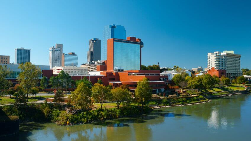 Downtown Little Rock skyline with the Arkansas River in the foreground.