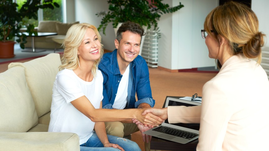 Shot of an investment advisor businesswoman consulting with her clients.