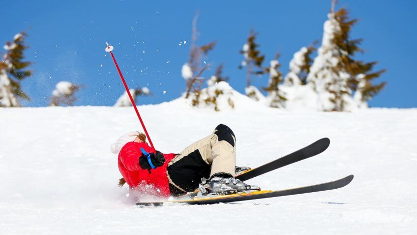 girl-skier-falling-down-white