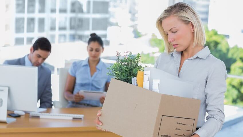 sad-businesswoman-leaving-office-after-being-laid-off
