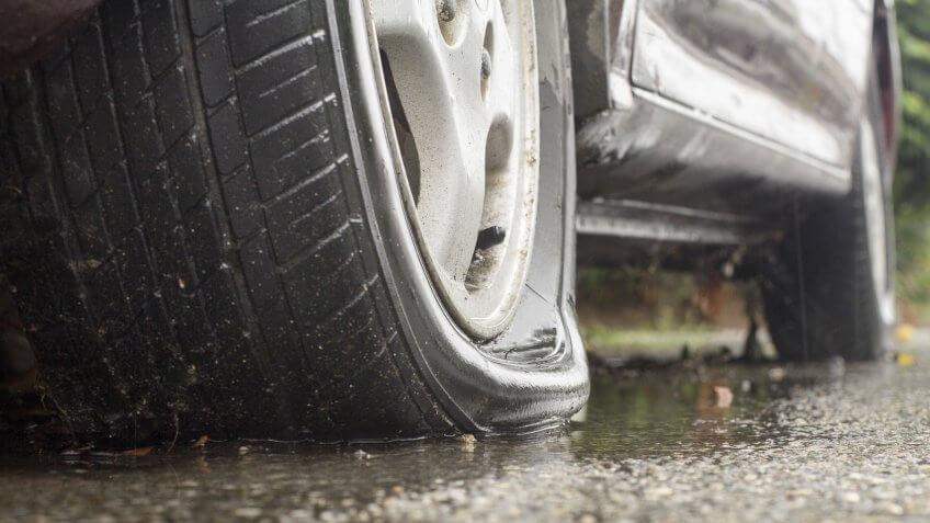 car-flat-tire-rainy-day