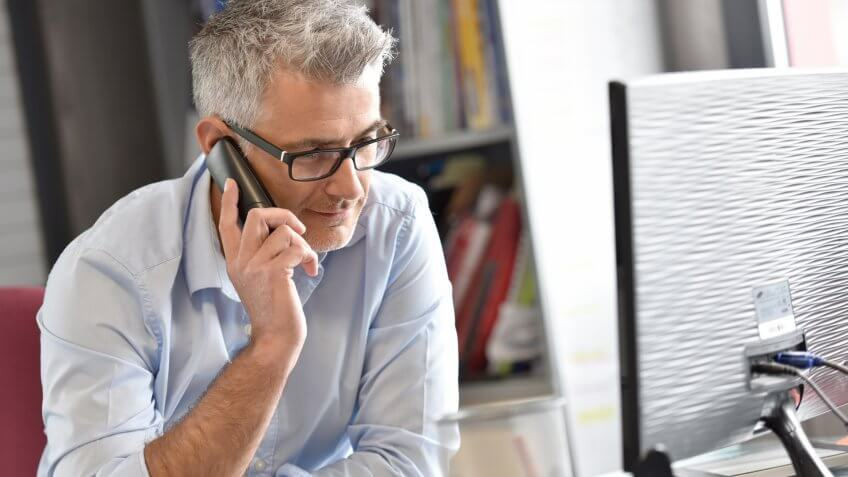 businessman-office-talking-on-phone