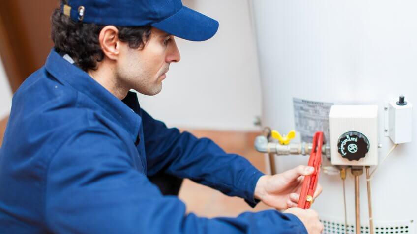 plumber-fixing-hotwater-heater