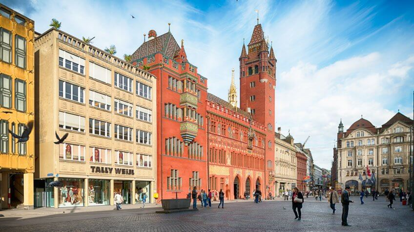 Basel, Switzerland - May 30, 2013: View at the Basel Town Hall and the Marktplatz in the center of Basel.
