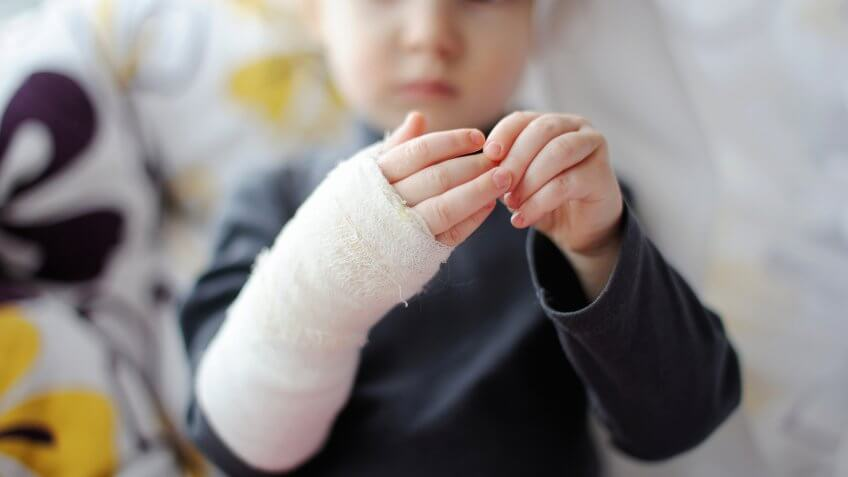 little-baby-girl-showing-her-bandaged