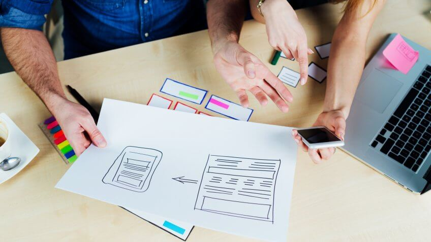 two-web-designers-brainstorming-ideas-sketching