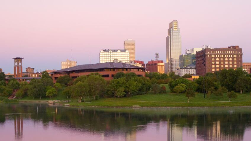 Lake in a park in downtown Omaha at dawn.