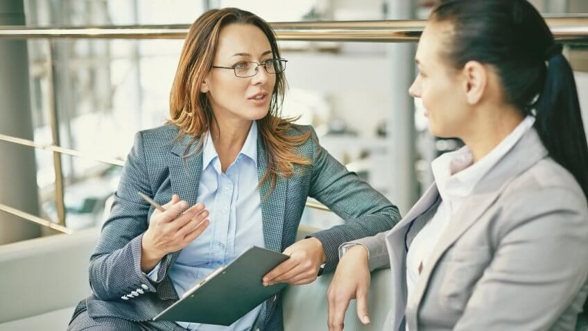 Hr manager asking questions to female candidate.