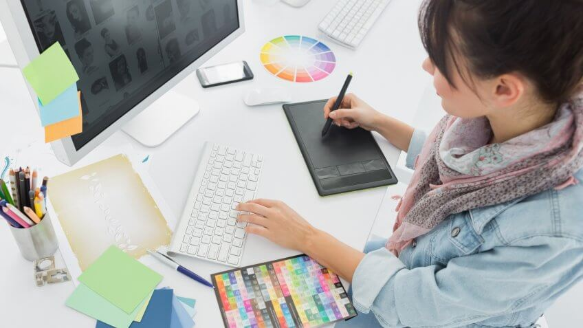 graphic designer working with a tablet