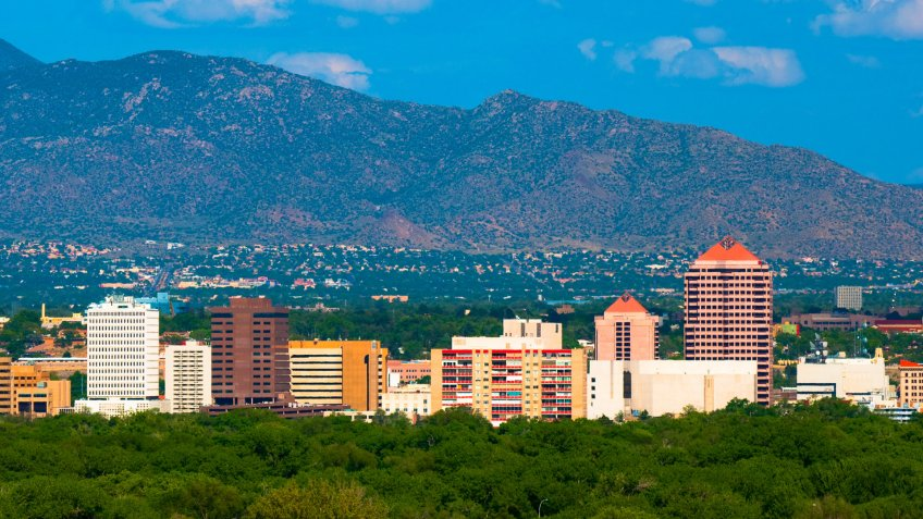 Albuquerque downtown skyline with the Sandia Mountains in the background.
