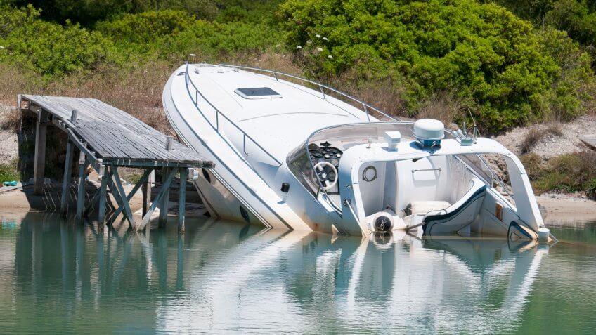 speedboat-beached-partially-sunk-mooring