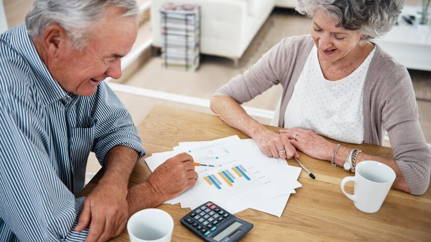 Cropped shot of a senior couple reviewing their financial investments