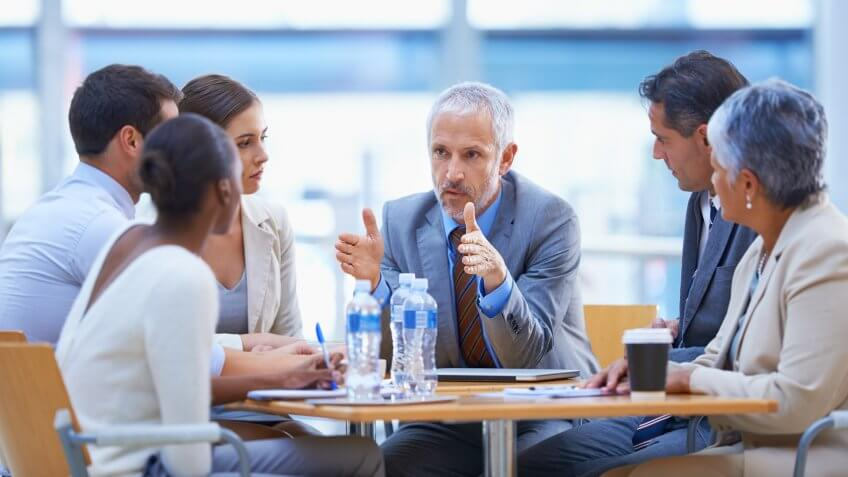 businessman sharing an idea with colleagues at a meeting