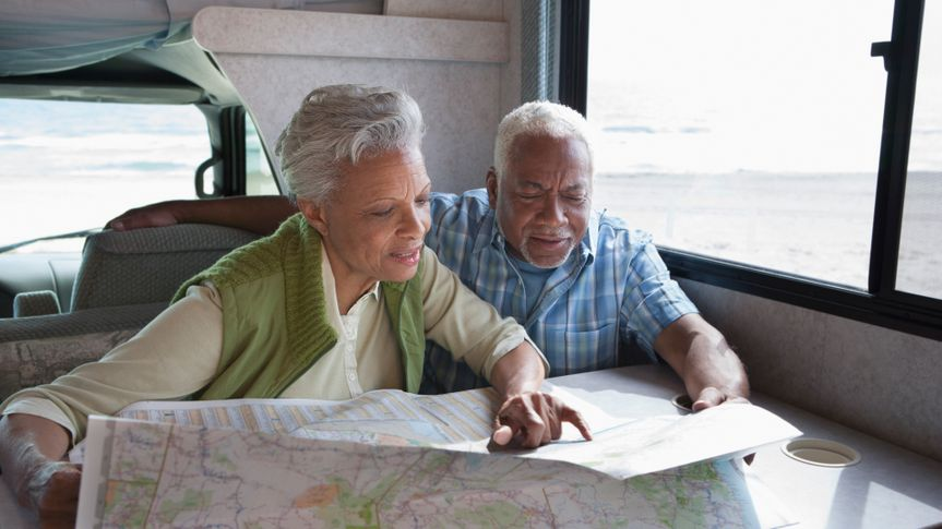 60-64 years, 6992, Active Seniors, Adventure, Beach, Bonding, Color Image, Day, Getting Away From It All, Gray Hair, Head And Shoulders, Heterosexual Couple, High Angle View, Horizontal, Los Angeles, Map, Photography, Pointing, Reading, Senior Adult, Senior Couple, Senior Men, Senior Women, Serious, Sitting, Sunny, Table, Transportation, Travel, Two People, United States, Vacations, Vehicle Interior, african-american ethnicity, man, motor home, ocean, people, retirement, together, woman