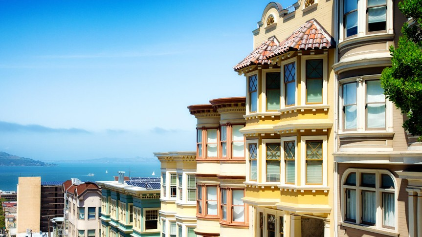 Colorful San Francisco building tops with Bay on a Sunny day.