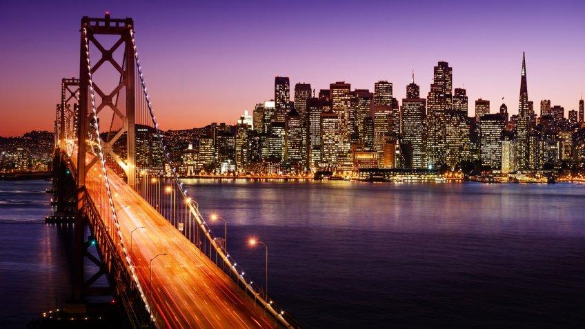 San Francisco skyline and Bay Bridge at sunset, California.