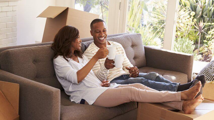 couple-on-sofa-taking-break-unpacking