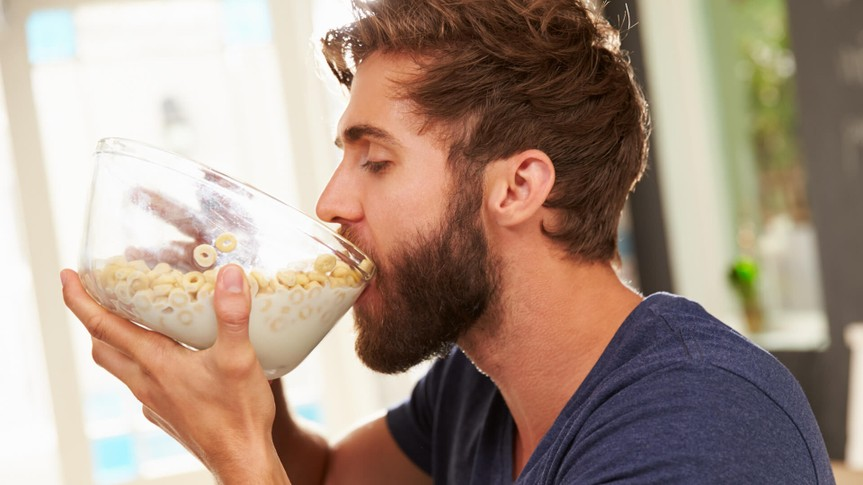 hungry-young-man-eating-breakfast-cereal