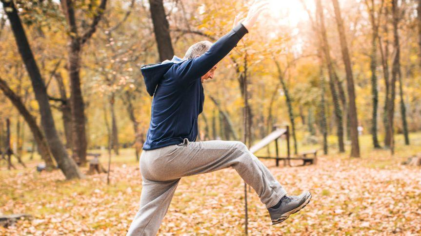 The photo of a senior man exercising.