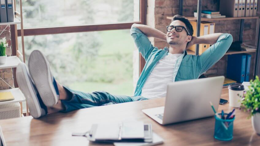 man having a rest after solving all the tasks at work