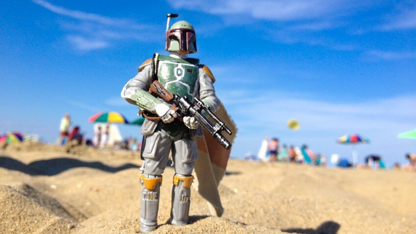 AVON, NEW JERSEY: AUGUST 15, 2013: Star Wars figure of Boba Fett on a beach.