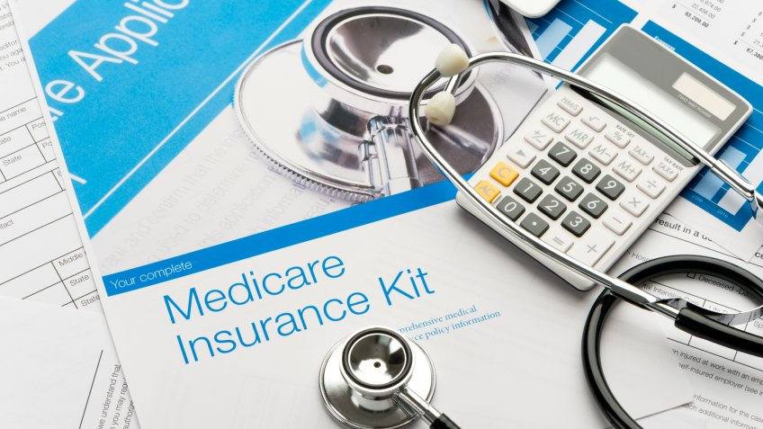 Medicare brochure with paperwork.