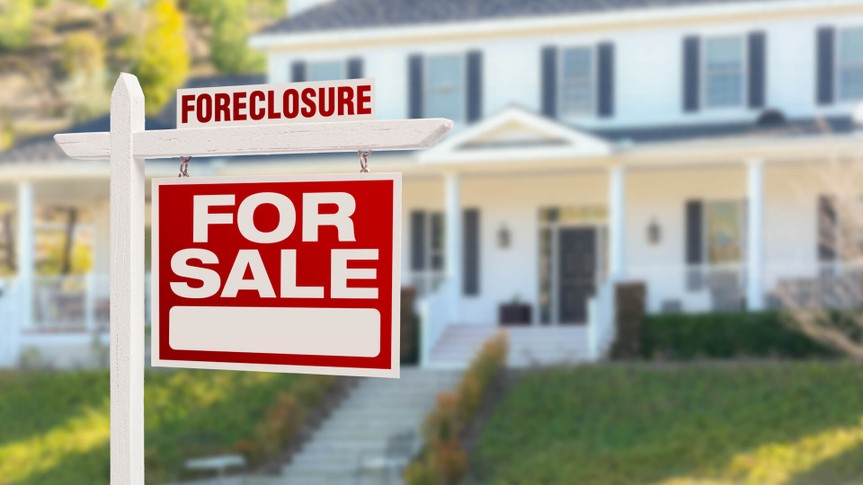 Foreclosure Home For Sale Real Estate Sign in Front of Beautiful Majestic House.
