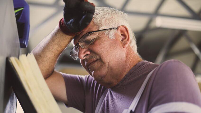 Senior man in workshop.