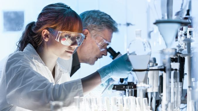 Health care researchers working in life science laboratory.