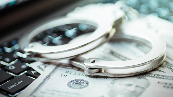Internet crimes and handcuffs.