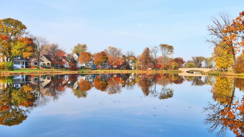 Beautiful fall landscape with a bridge in the city park.