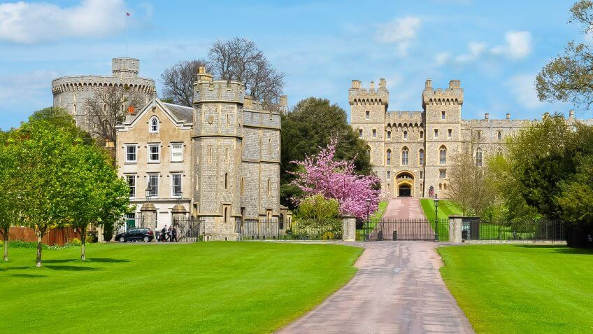 Long walk alley to Windsor castle in spring, London suburbs, UK.