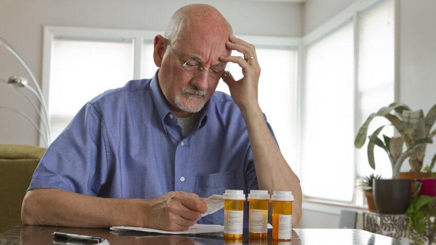 Headache, elderly man, healthcare, healthcare costs, prescription, senior
