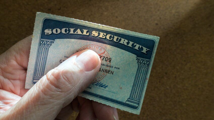 man holding social security card.