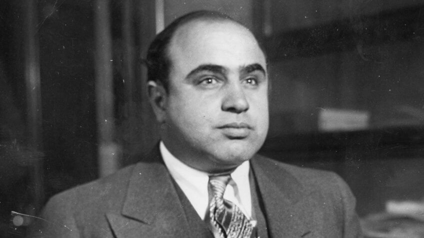 """Scarface"""" Al Capone is shown here at the Chicago Detective bureau following his arrest on a vagrancy charge as Public Enemy No."""