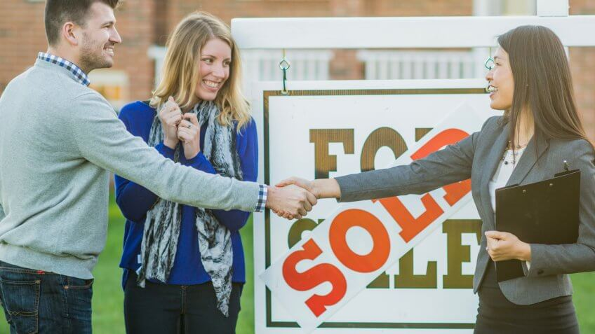 A Caucasian heterosexual couple have just purchased a new house.