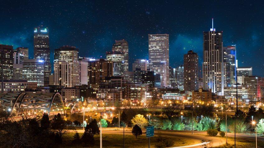 Denver, Colorado, city skyline under a night sky.