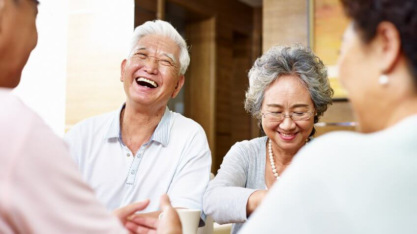 senior asian people getting together and having a good time.
