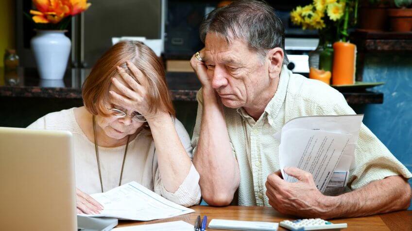 debt, elderly couple, financial struggle, paying bills, seniors