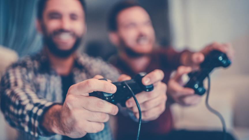 Two Excited Friends Playing Video Games.