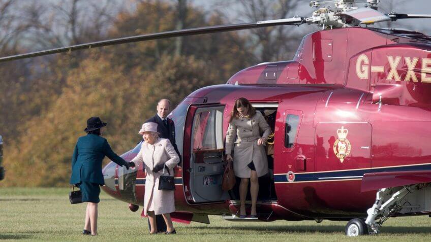 Queen Elizabeth II arriving by helicopter