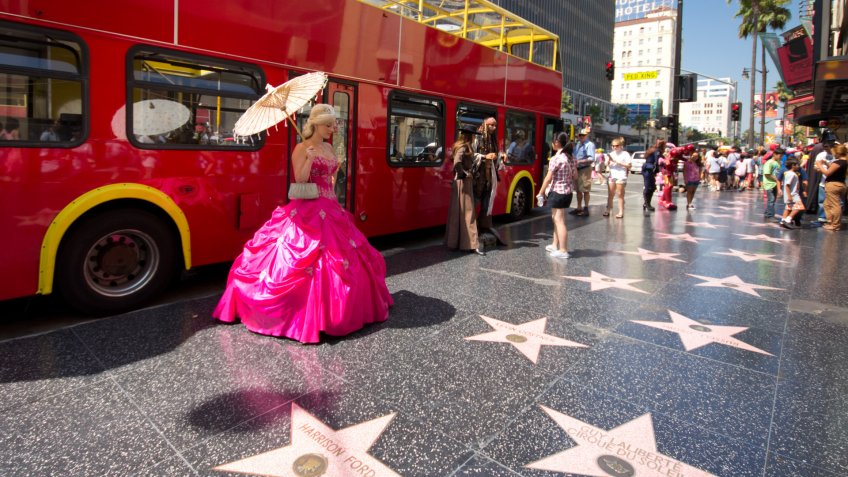 Hollywood, California, USA - August 11, 2012: Street performer and tourists on the star lined Hollywood Walk of Fame on Hollywood Blvd in Los Angeles, CA on August.