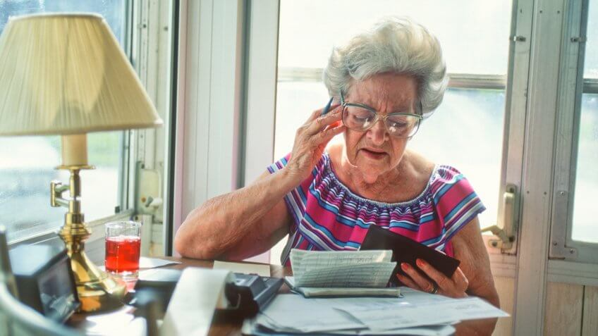senior woman confused over finances.