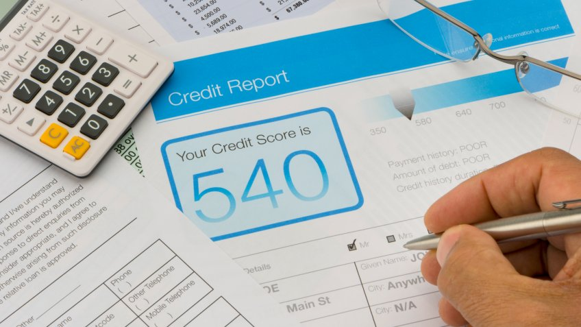 Credit report form on a desk with other paperwork.