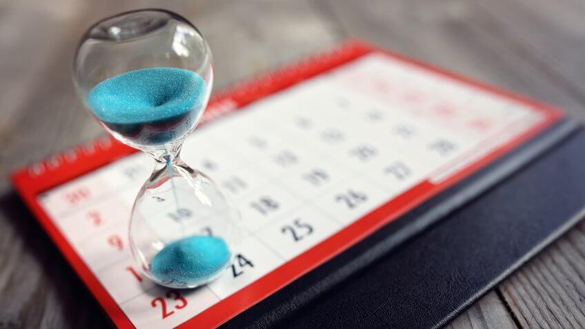 Hour glass on calendar